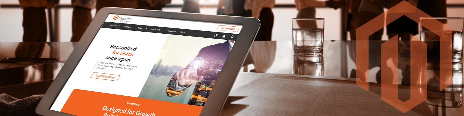 Banner image of a Magento developer holding a tablet