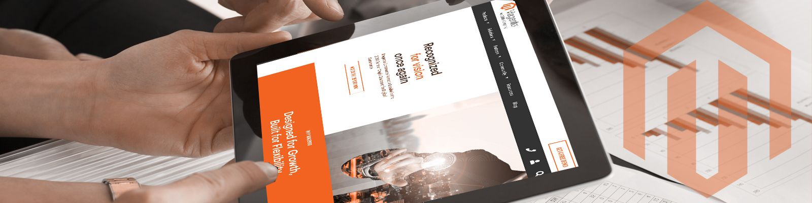 Closeup banner image of a Magento professional working on a tablet